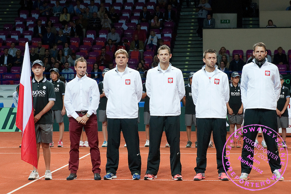 (L-R) Radoslaw Szymanik - captain national team & Marcin Matkowski & Mariusz Fyrstenberg & Michal Przysiezny & Lukasz Kubot all from Poland while national anthem before the BNP Paribas Davis Cup 2013 between Poland and Australia at Torwar Hall in Warsaw on September 13, 2013.<br /> <br /> Poland, Warsaw, September 13, 2013<br /> <br /> Picture also available in RAW (NEF) or TIFF format on special request.<br /> <br /> For editorial use only. Any commercial or promotional use requires permission.<br /> <br /> Photo by © Adam Nurkiewicz / Mediasport