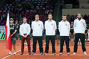 (L-R) Radoslaw Szymanik - captain national team &amp; Marcin Matkowski &amp; Mariusz Fyrstenberg &amp; Michal Przysiezny &amp; Lukasz Kubot all from Poland while national anthem before the BNP Paribas Davis Cup 2013 between Poland and Australia at Torwar Hall in Warsaw on September 13, 2013.<br /> <br /> Poland, Warsaw, September 13, 2013<br /> <br /> Picture also available in RAW (NEF) or TIFF format on special request.<br /> <br /> For editorial use only. Any commercial or promotional use requires permission.<br /> <br /> Photo by &copy; Adam Nurkiewicz / Mediasport