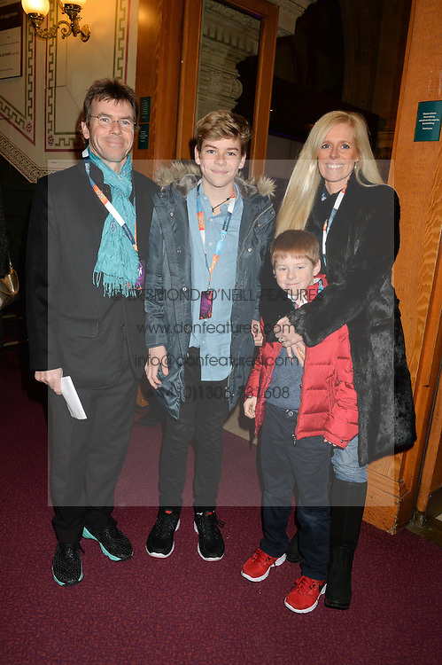 PAUL & VICTORIA STEWART with their sons ZAC (blue shirt) and ASHTON at the Cirque Du Soleil's VIP performance of Kooza at The Royal Albert Hall, London on 6th January 2015.