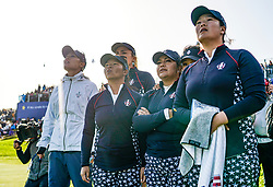 Solheim Cup 2019 at Centenary Course at Gleneagles in Scotland, UK. Pictured. Team USA players wait on 18th green for game between Marina Alex of USA and Suzann Pettersen of Europe on final day.
