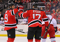 Feb 27, 2014; Newark, NJ, USA; New Jersey Devils left wing Ryane Clowe (29) and New Jersey Devils right wing Michael Ryder (17) celebrate Clowe's goal during the first period of their game against the Columbus Blue Jackets at Prudential Center.