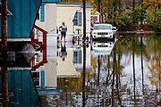 Residents in a trailer camp in Moonachie are evacuated after a levee broke due to the storm flooding caused by the Hurricane Sandy.