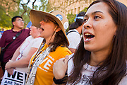 "22 OCTOBER 2011 - PHOENIX, AZ:    Protesters with Occupy Phoenix form a human chain to block access to counter protesters in Phoenix Saturday. The demonstrations at Occupy Phoenix, AZ, entered their second week Saturday. About 50 people are staying in Cesar Chavez Plaza, in the heart of downtown. The crowd grows in the evening and on weekends. Protesters have coordinated their actions with police and have gotten permission from the city to set up shade shelters and sleep in the park, but without tents or sleeping bags, which is considered ""urban camping,"" instead protesters are sleeping on the sidewalk. PHOTO BY JACK KURTZ"