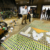 Adam Robison | BUY AT PHOTOS.DJOURNAL.COM<br /> Caterpillar employees look over their food sculpture they built in the shape of the state of Mississippi, as the voting process started for best sculpture during the 2015 United Way Campaign Celebration Thursday at the BancorpSouth Arena in Tupelo.