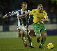 Photo: Aidan Ellis.<br /> Huddersfield Town v Swansea City. Coca Cola League 1. 30/12/2006.<br /> Swansea's Ian Craney (R) skips away from Huddersfield's Jon Worthington