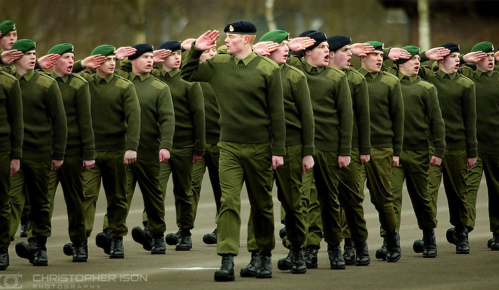 A young recruit salues the wrong way as he learns parade drill with his colleages on Basic Training at the Army Training Regiment near Winchester.