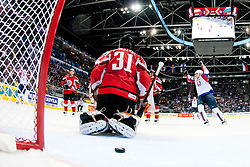 Slovenia scores a goal, puck behind Fabian Weinhandl of Austria during the ice-hockey match between Austria and Slovenia of Group G in Relegation Round of IIHF 2011 World Championship Slovakia, on May 7, 2011 in Orange Arena, Bratislava, Slovakia (Photo by Matic Klansek Velej, Vid Ponikvar / Sportida)