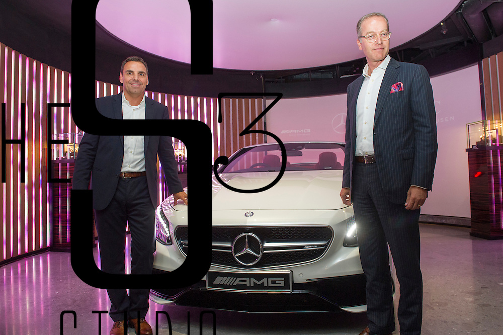 Andreas Binder, President and CEO of Mercedes-Benz Hong Kong, left, and Goris Verburg, Managing Director North East Asia of IWC Schaffhausen, right, unveil a Mercedes Cabriolet for the first time in Hong Kong during an IWC and Mercedes joint event on 24 August 2016 in Entertainment Building, Hong Kong, China. Photo by Lucas Schifres / studioEAST