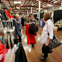 Thomas Wells   BUY AT PHOTOS.DJOURNAL.COM<br /> Linda Heavner, center, and Joyce Pearson look for some new clothes during Thursday's Celebration Village at Tupelo Furniture Market.