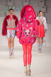 © Licensed to London News Pictures. 01/06/2014. London, England. Collection by Camilla Grimes from the Manchester School of Art. Graduate Fashion Week 2014, Runway Show at the Old Truman Brewery in London, United Kingdom. Photo credit: Bettina Strenske/LNP