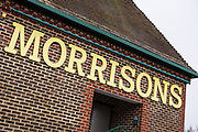 Large Morrisons sign outside the supermarket shop in Blandford Forum, United Kingdom.  Wm Morrison Supermarkets is the fourth largest chain of supermarkets in the United Kingdom.