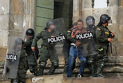 59594099 .Policemen arrest a man during a protest in commemoration of the International Labour Day in Bogota, capital of Colombia, May 1, 2013,  May 2, 2013 Photo by: i-Images.UK ONLY
