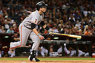 PHOENIX, AZ - MAY 14:  Buster Posey #28 of the San Francisco Giants hits a ground rule double driving in two runs in the ninth inning against the Arizona Diamondbacks at Chase Field on May 14, 2016 in Phoenix, Arizona.  (Photo by Jennifer Stewart/Getty Images)