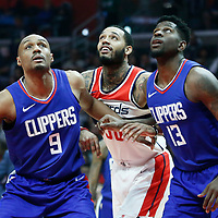09 December 2017: Washington Wizards forward Mike Scott (30) vies for the rebound with LA Clippers guard C.J. Williams (9) and LA Clippers forward Jamil Wilson (13) during the LA Clippers 113-112 victory over the Washington Wizards, at the Staples Center, Los Angeles, California, USA.