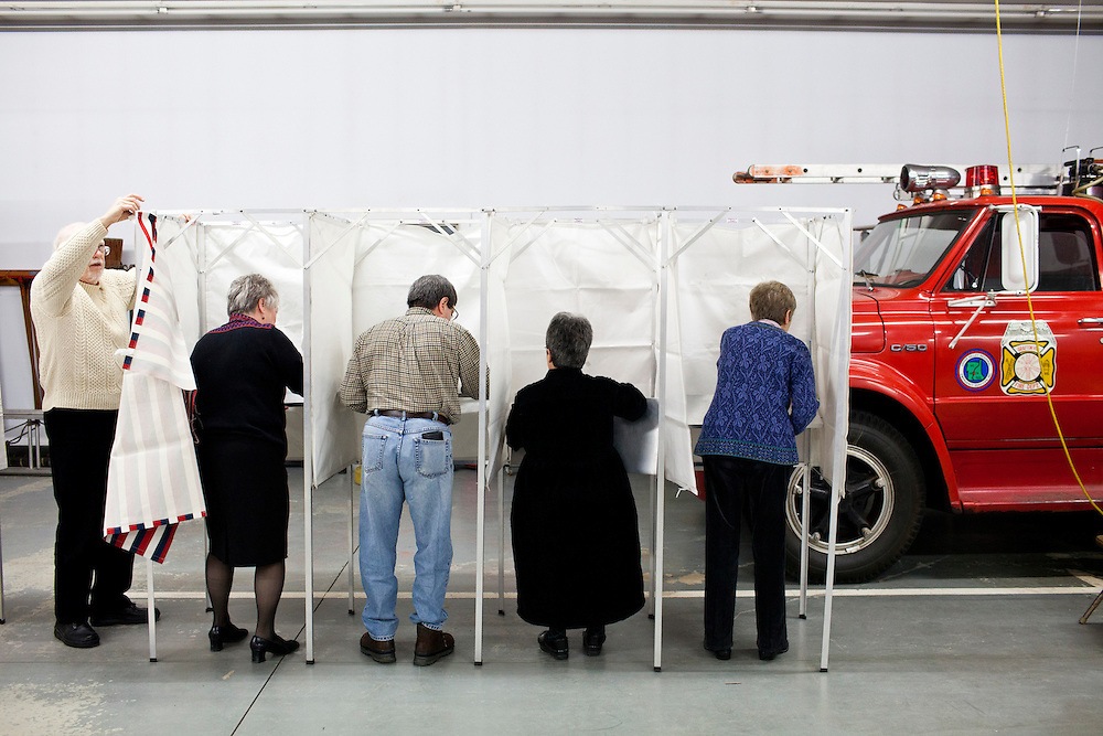 Mac Warren, Bonnie Haubrich, David Rienzo, Susan Frost, and Dorothy Campbell, from left, assemble voting booths for primary voting at the Grafton Fire Station on Tuesday, January 10, 2012 in Grafton, NH. Brendan Hoffman for the New York Times