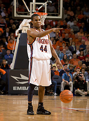 Virginia guard Sean Singletary (44) directs traffic against Maryland.  The Virginia Cavaliers defeated the Maryland Terrapins 91-76 at the University of Virginia's John Paul Jones Arena  in Charlottesville, VA on March 9, 2008.