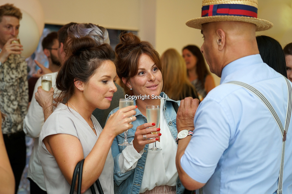 London,England,UK, 11th Aug 2016 : Twin Rose and Maria attend the wine retailer hosts summer party to sample its award-winning sparkling wine range at Icetank Studios, Lo0ndon,UK. Photo by See Li