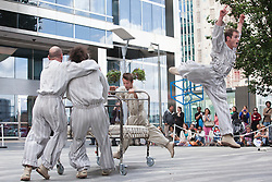 © Licensed to London News Pictures. 30/06/2012. London, England. Expedition Paddock performed by Tango Sumo. Dancing City at Canary Wharf. Free outdoor dance performances at Canary Wharf. Dancing City is part of the Greenwich and Docklands International Festival, GILF 2012. Photo credit: Bettina Strenske/LNP