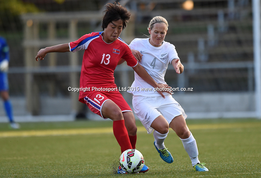 Korea's Jo Yun Mi and Katie Hoyle. Womens Football. New Zealand Football Ferns v Korea DPR. Auckland, New Zealand. Sunday 8 February 2015. Copyright Photo: Andrew Cornaga / www. Photosport.co.nz