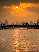 15 FEBRUARY 2015 - BANGKOK, THAILAND: Sunrise on the Chao Phraya River in Bangkok. This picture was made at the Santa Cruz pier in the Kudeejeen neighborhood.       PHOTO BY JACK KURTZ
