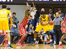 Feb 20, 2016; Morgantown, WV, USA; West Virginia Mountaineers forward Devin Williams (41) is guarded by Oklahoma Sooners forward Khadeem Lattin (12) during the first half at the WVU Coliseum. Mandatory Credit: Ben Queen-USA TODAY Sports