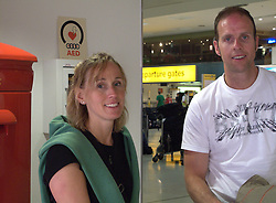 UK ENGLAND LONDON 15APR10 - Stranded airline passengers Tanja Schempf (33, L) and Thorsten Herrling (36, R) from Illingen, Stuttgart stand at Heathrow's Terminal 1 awaiting further news of air traffic. Today the UK's airspace was totally closed due to high altitude ash clouds after a volcanic eruption in Iceland...jre/Photo by Jiri Rezac..© Jiri Rezac 2010