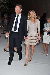 LORD ST.JOHN OF BLETSO and SABINA McTAGGART at a dinner hosted by Cartier following the following the opening of the Chelsea Flower Show 2012 held at Battersea Power Station, London on 21st May 2012.