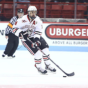 Braden Pimm #14 of the Northeastern Huskies controls the puck during the game at Matthews Arena on January 18, 2014 in Boston, Massachusetts. (Photo by Elan Kawesch)