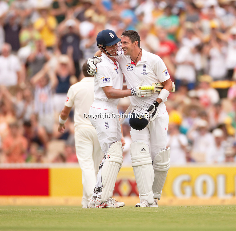 Kevin Pietersen (right) celebrates his century (with Alastair Cook) in the second Ashes Test Match between Australia and England at the Adelaide Oval. Photo: Graham Morris (Tel: +44(0)20 8969 4192 Email: sales@cricketpix.com) 5/12/10