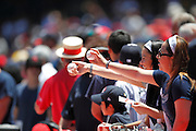 ANAHEIM, CA - JUNE 05:  Fans hold out balls with the hope of getting an autograph at the Los Angeles Angels of Anaheim game against the New York Yankees on June 5, 2011 at Angel Stadium in Anaheim, California. The Yankees won the game 5-3. (Photo by Paul Spinelli/MLB Photos via Getty Images)