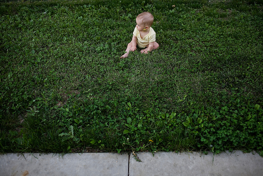 Madelyn Avery Eich, 6 months, plays outside of her home in the grass on a warm spring day in Athens, Ohio on Friday, April 25, 2008.