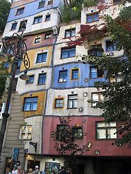 Windows, balcony and decoration of the Hundertwasserhaus, Vienna, Wien, Austria