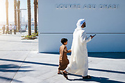 Abu Dhabi, United Arab Emirates (UAE), December 21, 2017.  People visit the Louvre Abu Dhabi displaying 600 art pieces including 300 artworks rented from the Louvre, in Abu Dhabi, UAE.  the Louvre Abu Dhabi Museum striking structure, masterminded by the genius of French architect Jean Nouvel, houses a museum city where culture is very much the capital.