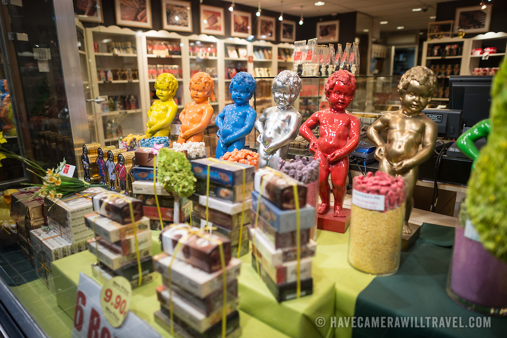 The Neuhaus chocolate shop next to the Mannekin Pis in the Lower Town of Brussels uses colored models of the Mannekin Pis in its window display case.