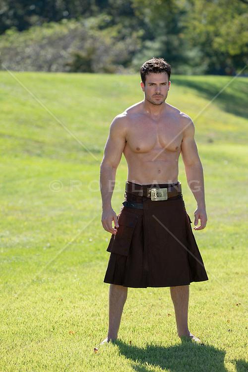muscular man in a kilt outdoors shirtless muscular man in a kilt outdoors