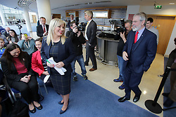 © Licensed to London News Pictures. 6/02/2016. Belfast, Northern Ireland, UK. Sinn Fein's leader in the North of Ireland Michelle O'Neill waits for the Party President Gerry Adams before the Launch of their Candicates for the forth coming elections in Northern Ireland. The fallout from the RHI scandal surrounding the scheme, which is approximately £490m over budget, resulted in the resignation of Sinn Fein's deputy first minister, Martin McGuinness, the collapse of Stormont's institutions and the calling of snap elections on 2 March.  Photo credit : Paul McErlane/LNP