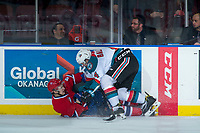 KELOWNA, CANADA - JANUARY 10: Zach Fischer #9 of the Spokane Chiefs is checked to the ice by Gordie Ballhorn #4 of the Kelowna Rockets during first period on January 10, 2017 at Prospera Place in Kelowna, British Columbia, Canada.  (Photo by Marissa Baecker/Shoot the Breeze)  *** Local Caption ***