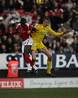 Photo: Lee Earle.<br /> Charlton Athletic v Liverpool. The Barclays Premiership. 16/12/2006. Charlton's Souleymane Diawara (L) clashes with Peter Crouch.