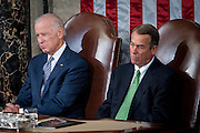 Vice President Joe Biden and Speaker of the House John Boehner look on as Pope Francis continues his six-day U.S. tour speaking to a joint meeting of Congress at the U.S. Capitol in Washington, District of Columbia, U.S., on Thursday, Sept. 24, 2015. The Pope is calling for Americans to do more to fight poverty, curb climate change and help immigrants. His visit runs through Sept. 27, and features stops in Washington, New York and Philadelphia.