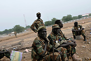 SPLA soldiers on a large, open terrain just opposite John Garang's tomb in Juba where hundreds of unexploded ordinance were found scattered across the area as it was being prepared for South Sudan independence ceremonies. The Government of South Sudan called on Mines Advisory Group (MAG) to assist SPLA deminers in an attempt to clear the area and make it safe for the thousands of people and dignitaries who will be attending the declaration of independence on July 9th...Juba, South Sudan. 04/07/2011..Photo © J.B. Russell