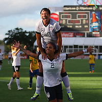 U.S. forward Sydney Leroux (2) and U.S. forward Abby Wambach (20) celebrate after Leroux scored the first goal of the game, during a women's soccer International friendly match between Brazil and the United States National Team, at the Florida Citrus Bowl  on Sunday, November 10, 2013 in Orlando, Florida. (AP Photo/Alex Menendez)