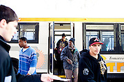 Bus riders depart a CTRAN bus at the stop at Hartsfield-Jackson Atlanta International Airport March 31, 2010. March 31, 2010 marked Clayton County, Georgia's last day of the county's public bus system, CTRAN, running. Many CTRAN riders took the now discontinued bus routes to work at the airport.