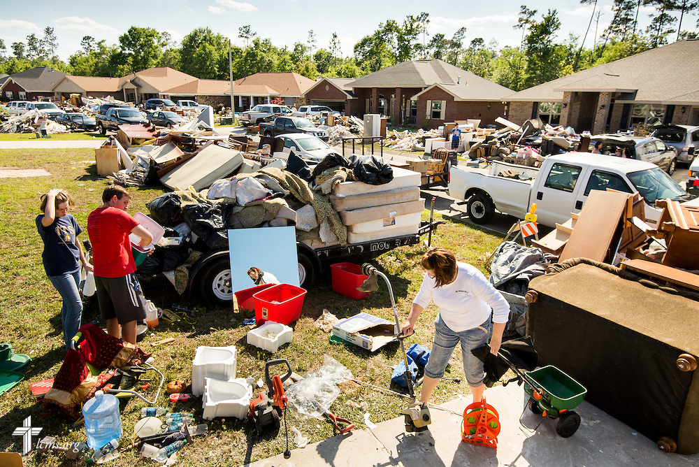 Volunteers sort through flood-damaged items outside the  home of the Rev. Randy Blankschaen, pastor of Immanuel Lutheran Church, and his wife Lydia, at the pastor's home in Pensacola, Fla., on Saturday, May 3, 2014. A torrential rainfall flooded severely damaged homes in the neighborhood. LCMS Communications/Erik M. Lunsford