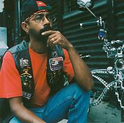 Man kneeling next to his schwinn bike, USA
