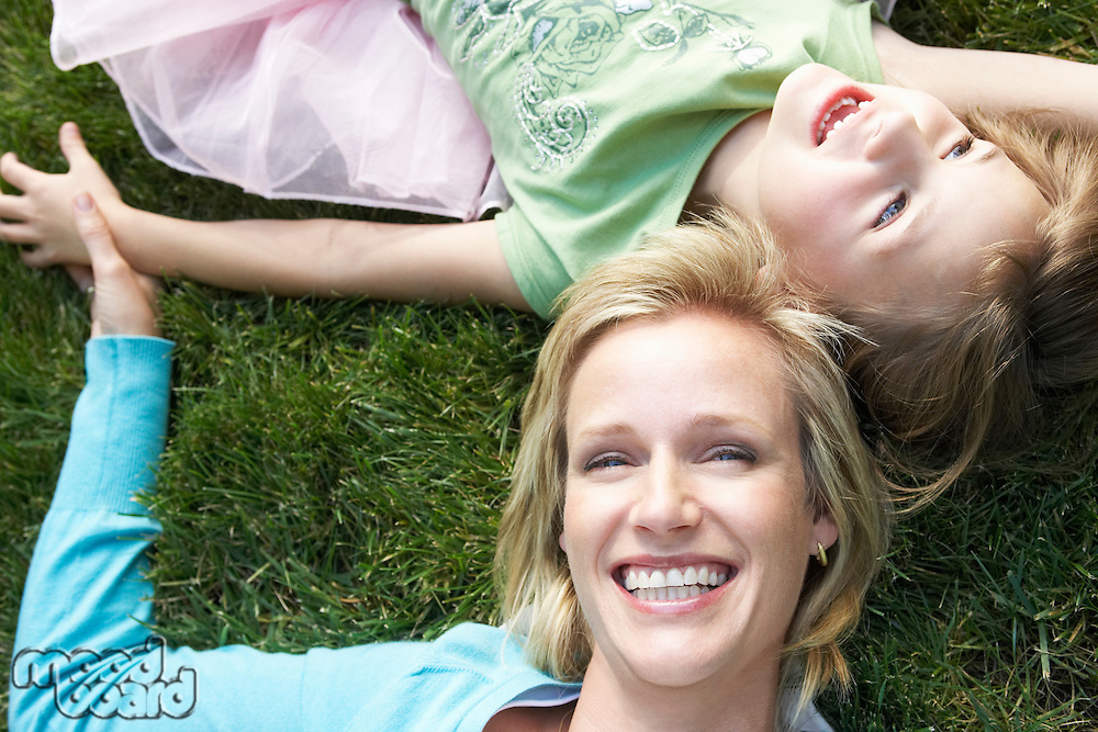 Mother and Daughter Relaxing in the Grass
