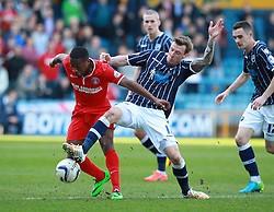 Millwall's Martyn Woolford tackles Charlton Athletic's Callum Harriott - Photo mandatory by-line: Robin White/JMP - Tel: Mobile: 07966 386802 15/03/2014 - SPORT - FOOTBALL - The Den - Millwall - Millwall v Charlton Athletic - Sky Bet Championship