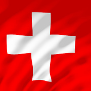 The Swiss flag shown with ripples caused by the wind.