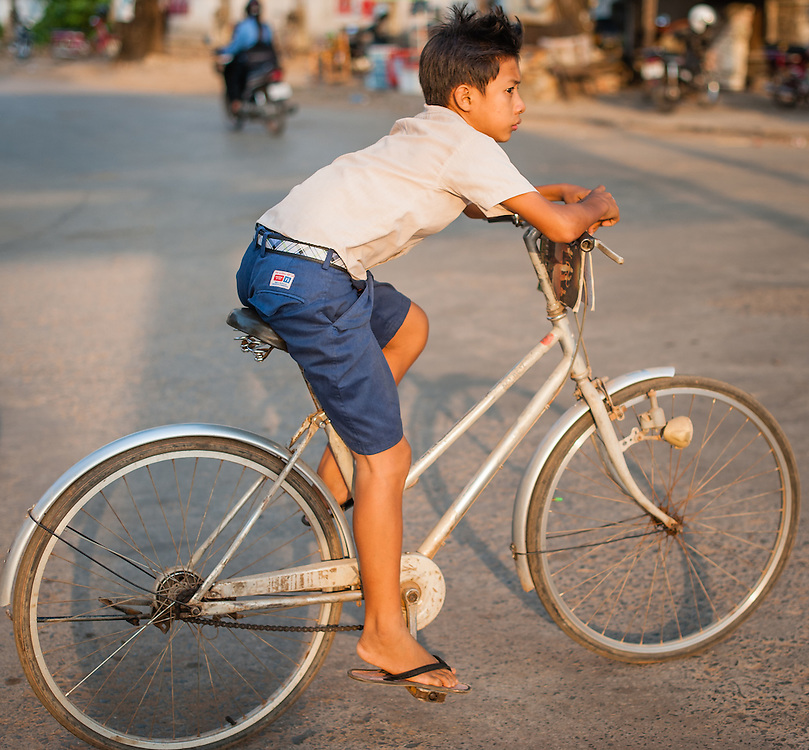 Boy on shorts on bicycle