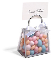 Mini purse of Jordan almonds place card on white background