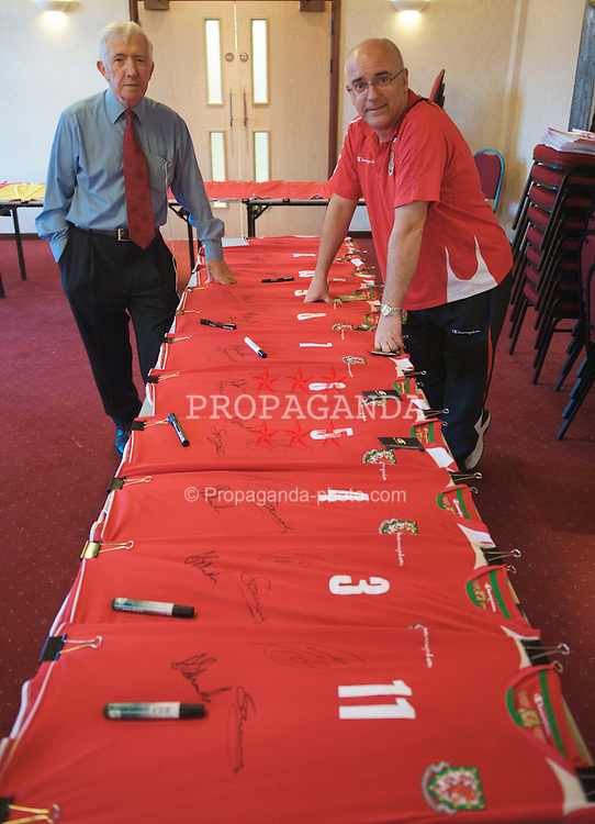 CARDIFF, WALES - Wednesday, March 25, 2009: Wales' press officer Ceri Stennett (R) and Matt Southall organise a signing session for the Wales squad at the Vale of Glamorgan ahead of the 2010 FIFA World Cup Qualifying Group 4 match against Finland. (Pic by David Rawcliffe/Propaganda)
